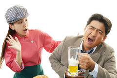 Waitress and drunk customer Royalty Free Stock Images
