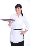 Waitress with an empty tray Stock Photo