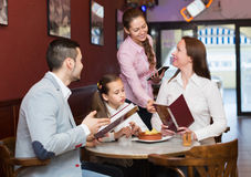 Waitress and family at cafe Royalty Free Stock Images