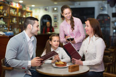 Waitress and family at cafe Stock Image