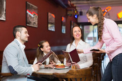 Waitress and family at cafe Royalty Free Stock Image