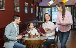 Waitress and family at cafe Royalty Free Stock Photo