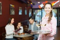 Waitress and family at cafe Stock Photo