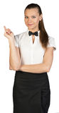 Waitress with finger pointing up and looking Royalty Free Stock Photography