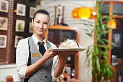 Waitress girl with cake on plate at restaurant Royalty Free Stock Image