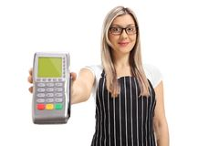 Waitress giving a payment terminal. Isolated on white background Royalty Free Stock Photo