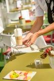 Waitress hands close up serving latte cafe Stock Images