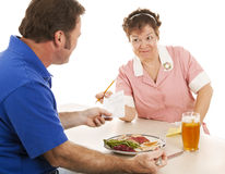 Waitress Hands Customer the Bill Stock Image