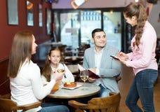 Waitress and happy family Stock Image