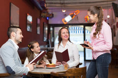 Waitress and happy family Stock Images
