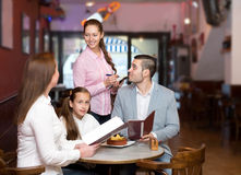 Waitress and happy family Stock Photography