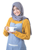 Waitress with head scarf serving coffee Royalty Free Stock Images