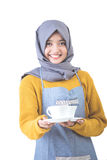 Waitress with head scarf serving coffee Stock Photo