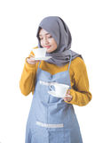 Waitress with head scarf serving coffee Royalty Free Stock Photography