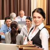 Waitress hold menu business people at restaurant. Young waitress hold menu business people have lunch at restaurant Stock Images
