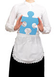 Waitress holding a blue puzzle piece Royalty Free Stock Photos