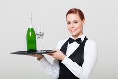 Waitress holding champagne Royalty Free Stock Photography