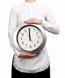 Waitress holding a clock Royalty Free Stock Photo