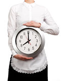 Waitress holding a clock Royalty Free Stock Images