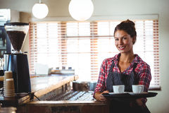 Waitress holding coffees Stock Photography