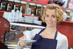 Waitress holding cup coffee Royalty Free Stock Image