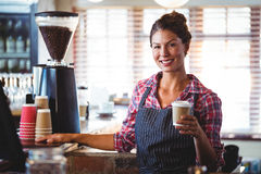 Waitress holding a cup of coffee Stock Photo