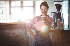 Waitress holding a cup of coffee Stock Image