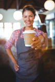 Waitress holding a cup of coffee Royalty Free Stock Images