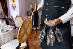 Waitress holding a dish of champagne and wine glasses at some fe Royalty Free Stock Image