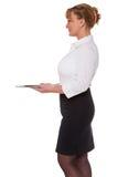 Waitress holding an empty silver tray Royalty Free Stock Photos