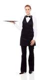 Waitress holding empty tray Stock Image