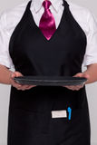 Waitress holding an empty tray Stock Images