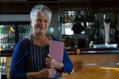 Waitress holding menu card Royalty Free Stock Image