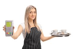 Waitress holding a payment terminal and a tray with two cups of. Coffee isolated on white background Royalty Free Stock Images