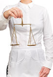 Waitress holding a scale of justice Stock Images