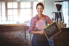 Waitress holding a sign with open Royalty Free Stock Image