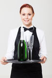 Waitress holding tray Stock Photo