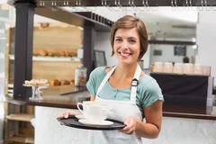 Waitress holding tray with cappuccinos Stock Photography