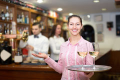 Waitress holding tray with glasses Royalty Free Stock Images