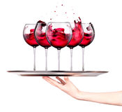 Waitress holding tray with wine glasses Stock Photography