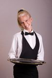Waitress holds silver platter Stock Photo