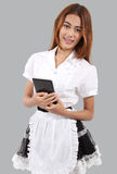 Waitress. Image of asian young waitress in white blouse and hold tablet in her hand Stock Photography