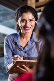 Waitress in indian restaurant taking orders Stock Image