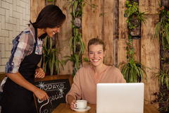 Waitress interacting with costumer Stock Images