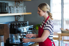 Waitress making cup of coffee Stock Photography