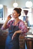 Waitress making a phone call Stock Photos