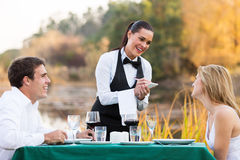 Waitress order couple Royalty Free Stock Photography