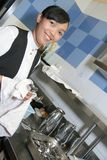 Waitress polishing cutleries Royalty Free Stock Photo