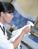 Waitress polishing glass royalty free stock photos