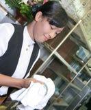Waitress polishing glass stock photos